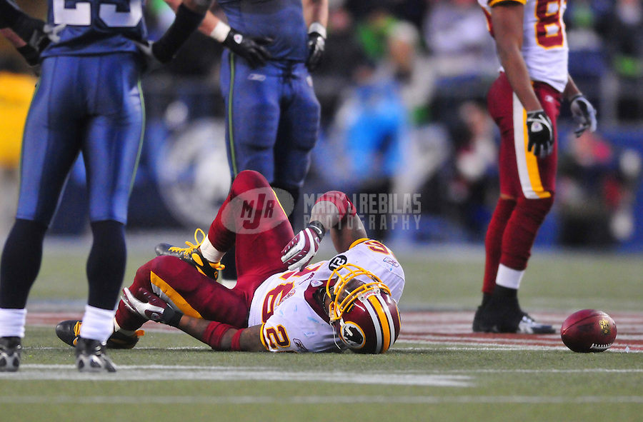 Jan. 5, 2008; Seattle, WA, USA; Washington Redskins running back Clinton Portis (26) lays on the ground after being injured in the fourth quarter against the Seattle Seahawks during the NFC wild card game at Qwest Field. Seattle defeated Washington 35-14. Mandatory Credit: Mark J. Rebilas-US PRESSWIRE