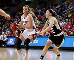 SIOUX FALLS, SD: MARCH 5: Ciara Duffy #24 from the University of South Dakota drives against Remy Davenport #33 from Nebraska Omaha during the Summit League Basketball Championship on March 5, 2017 at the Denny Sanford Premier Center in Sioux Falls, SD. (Photo by Dave Eggen/Inertia)