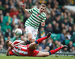 Ryan O'Leary slides in just as James Forrest cracks one off towards goal