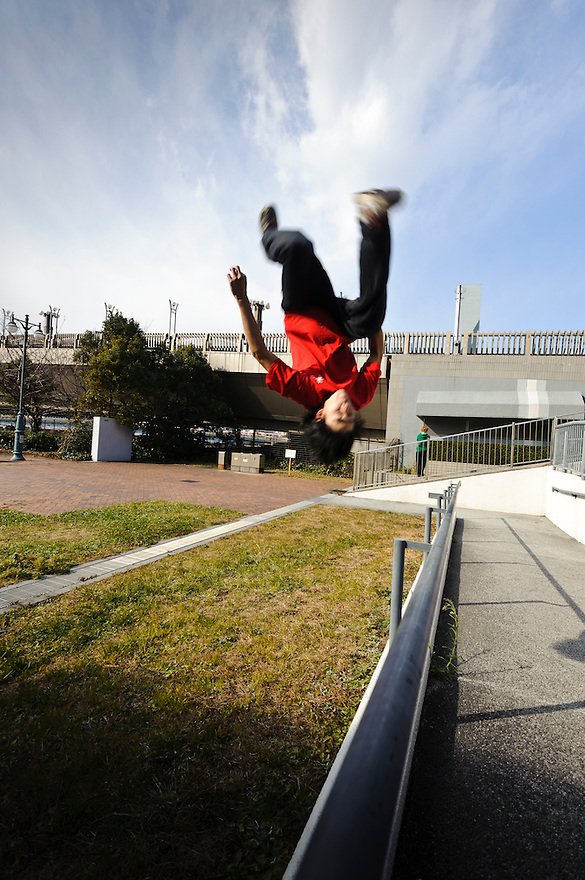"Traceur (parkour practitioner) ""Yutaro"" executing a flip. Practicing Parkour in Odaiba, Tokyo, Japan, January 27, 2012. Parkour is a modern method of physical training, also known as freerunning. It was founded in France in the 1990s. There is a small group of around 50 parkour practitioners in Tokyo."