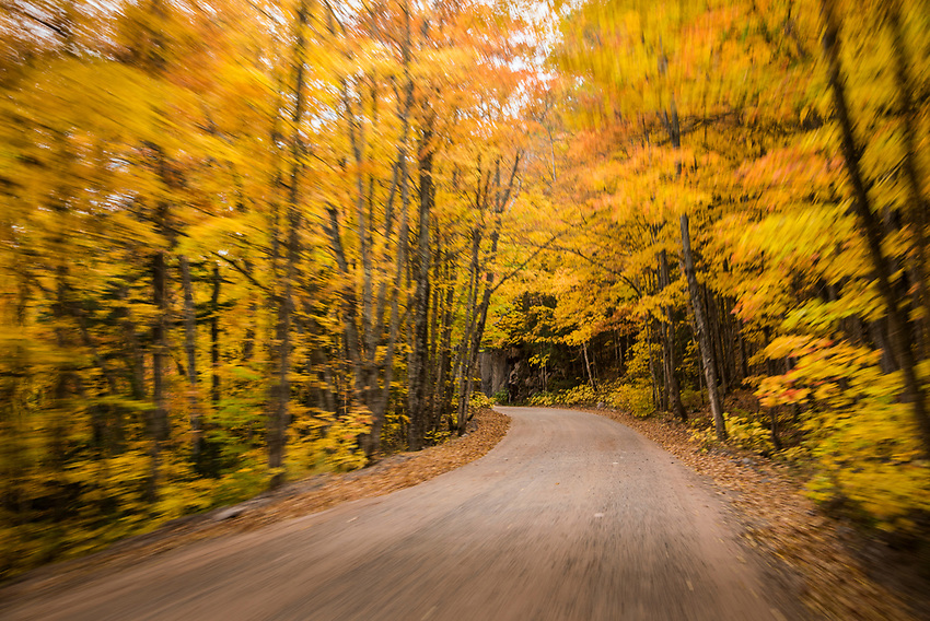 Fall color drive with motion blur along County Road 510 near Big Bay, Michigan.