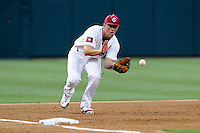 Third baseman Joey Pankake (9) of the South Carolina Gamecocks fields a ground ball in an NCAA Division I Baseball Regional Tournament game against the Campbell Camels on Friday, May 30, 2014, at Carolina Stadium in Columbia, South Carolina. South Carolina won, 5-2. (Tom Priddy/Four Seam Images)