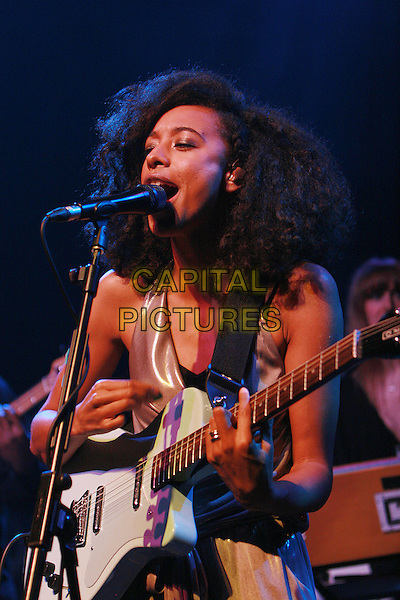 CORINNE BAILEY RAE.Performing live at Shepherd's Bush Empire, London, England..February 24th, 2010.stage concert live gig performance music gig half length beige gold lame playsuit microphone singing guitar .CAP/MAR.© Martin Harris/Capital Pictures.