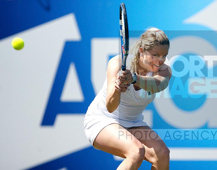 Kim Clijsters of Belgium plays a shot