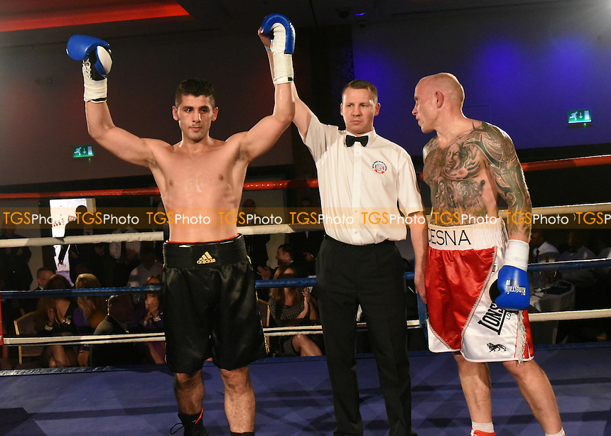Hasan Karkardi (black shorts) defeats Rolandas Cesna during a Boxing Show at the Royal Lancaster Hotel on 26th October 2015