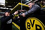 11.03.2018, Signal Iduna Park, Dortmund, GER, 1.FBL, Borussia Dortmund vs Eintracht Frankfurt, <br /> <br /> im Bild | picture shows:<br /> Peter St&ouml;ger | Stoeger (Trainer Borussia Dortmund) schreibt vor dem Spiel ein Autogramm f&uuml;r einen Fan auf der Trib&uuml;ne, <br /> <br /> <br /> Foto &copy; nordphoto / Rauch