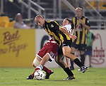 7 August 2007: FC Dallas's Clarence Goodson (11) pulls down Charleston's Lazo Alavanja (front). FC Dallas of Major League Soccer defeated the Charleston Battery of the United Soccer League first division 2-1 after extra time in a quarterfinal match of the 2007 US Open Cup tournament at Blackbaud Stadium in Charleston, SC...