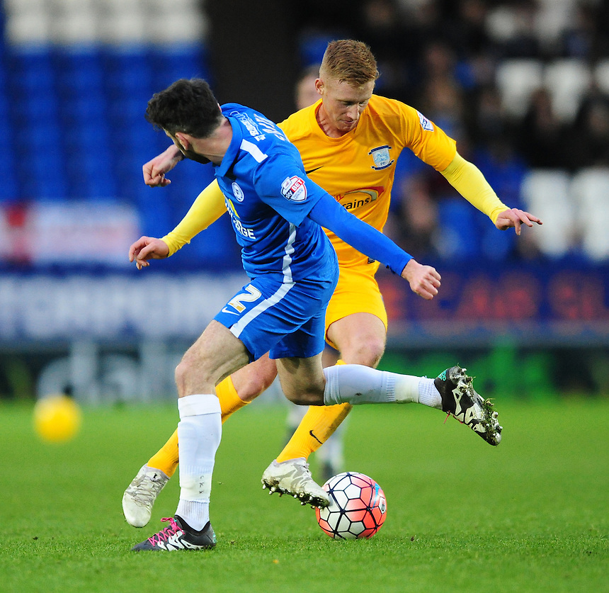 Preston North End&rsquo;s Eoin Doyle vies for possession with Peterborough United's Michael Smith<br /> <br /> Photographer Chris Vaughan/CameraSport<br /> <br /> Football - The FA Cup Third Round - Peterborough United v Preston North End - Saturday 9th January 2016 - ABAX Stadium - Peterborough <br /> <br /> &copy; CameraSport - 43 Linden Ave. Countesthorpe. Leicester. England. LE8 5PG - Tel: +44 (0) 116 277 4147 - admin@camerasport.com - www.camerasport.com
