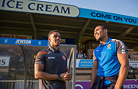 Paris Cowan-Hall of Wycombe Wanderers chats with Darius Charles of AFC Wimbledon ahead of the pre season friendly 'Cherry Red Records Cup' match between Wycombe Wanderers and AFC Wimbledon at Adams Park, High Wycombe, England on 25 July 2017. Photo by Andy Rowland.
