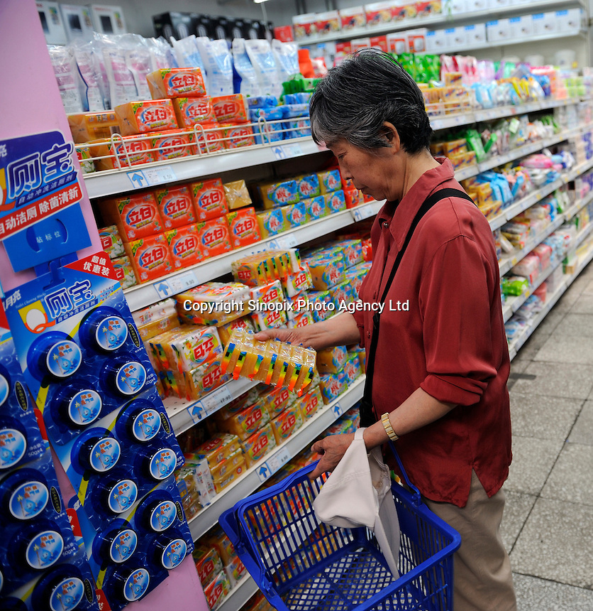 Chinese customer buying articles for washing at a Wu Mart supermarket in Beijing, China.  Wu Mart, the Beijing-based chain, was founded in the early 1990s by Zhang Wenzhong. Its name smacks of the fame of U.S. retail giant Wal-Mart. Wu Mart and Wal-Mart are competing in different arenas and each appears to be going after a different class of consumer. By 2005, Wu Mart had more than 450 hypermarkets, supermarkets and convenience stores, and is one of only a few Chinese retailers whose shares are publicly traded..28 May 2011