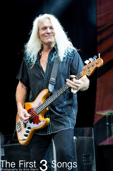 Bruce Hall of REO Speedwagon performs at Riverbend Music Center in Cincinnati, Ohio.