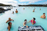 The Blue Lagoon in Reykjavik, Iceland. Bathers applying mud. Hurtigruten cruise.