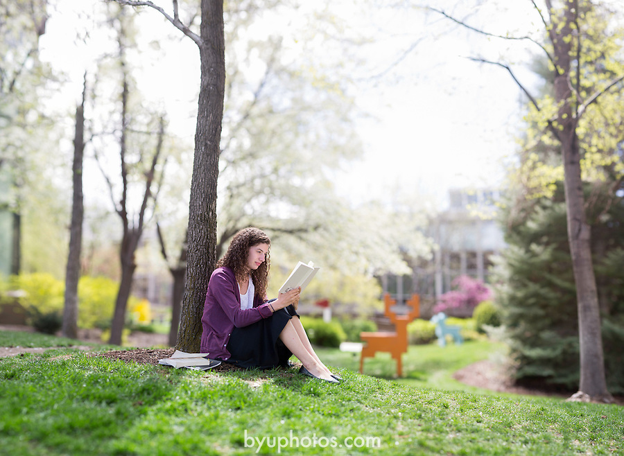 1304-63 117 C3 GCI Riana Portrait<br /> <br /> Portrait of student Riana Culp in the MOA Museum of Art Garden, Reading, Studying, Spring, Brenezier<br /> <br /> April 30, 2013<br /> <br /> Photo by Jonathan Hardy/BYU Photo<br /> <br /> &copy; BYU PHOTO 2013<br /> All Rights Reserved<br /> photo@byu.edu  (801)422-7322