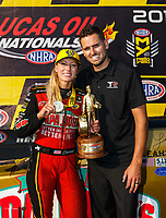 Aug 20, 2017; Brainerd, MN, USA; NHRA top fuel driver Leah Pritchett celebrates with husband Gary Pritchett after winning the Lucas Oil Nationals at Brainerd International Raceway. Mandatory Credit: Mark J. Rebilas-USA TODAY Sports