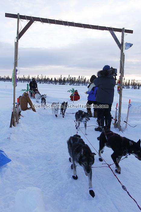 Thursday March, 2012  Lance Mackey arrives under the arch  at the Cripple checkpoint.   Iditarod 2012.