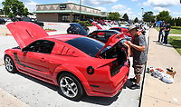 NWA Democrat-Gazette/J.T. WAMPLER Manny Wyndham of Bentonville shines his 2007 Ford Mustang GT Roush Stage 3 during a car show Sunday May 28, 2017 at the Springdale Civic Center. Steeze Nation and ARModified organized the show and obtained sponsors, leaving all of the entry fees going to Arkansas Children's Hospital Northwest. Around 100 cars participated in the event.