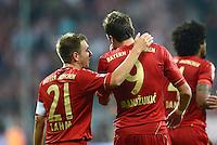 FUSSBALL   1. BUNDESLIGA  SAISON 2012/2013   5. Spieltag FC Bayern Muenchen - VFL Wolfsburg    25.09.2012 Jubel nach dem Tor mit Philipp Lahm und Mario Mandzukic (v. li., FC Bayern Muenchen)