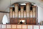 Organist playing inside Bronnoy Church, Bronnoysund, Nordland, Norway built in 1870