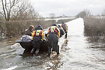 Flooding on the Somerset Levels, England in February 2014 - Huish Episcopi humanitarian support boat service to Muchelney village