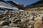 Mountain stream in the alps - Ritzingen in the Swiss alps- close to the Furkapass, Oberwald, Switzerland.boulders,