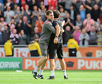 Lincoln City's strength and conditioning/sports massage Kieran Walker, left, hugs Lincoln City manager Danny Cowley at the end of the game<br /> <br /> Photographer Chris Vaughan/CameraSport<br /> <br /> The EFL Sky Bet Championship - Rotherham United v Lincoln City - Saturday 10th August 2019 - New York Stadium - Rotherham<br /> <br /> World Copyright © 2019 CameraSport. All rights reserved. 43 Linden Ave. Countesthorpe. Leicester. England. LE8 5PG - Tel: +44 (0) 116 277 4147 - admin@camerasport.com - www.camerasport.com