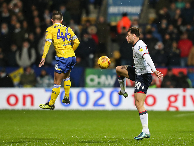 Bolton Wanderers' Yanic Wildschut competing with Leeds United's Jamie Shackleton<br /> <br /> Photographer Andrew Kearns/CameraSport<br /> <br /> The EFL Sky Bet Championship - Bolton Wanderers v Leeds United - Saturday 15th December 2018 - University of Bolton Stadium - Bolton<br /> <br /> World Copyright © 2018 CameraSport. All rights reserved. 43 Linden Ave. Countesthorpe. Leicester. England. LE8 5PG - Tel: +44 (0) 116 277 4147 - admin@camerasport.com - www.camerasport.com
