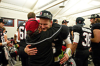 STANFORD, CA-NOVEMBER 30, 2012 - Josh Nunes celebrates a Cardinal win in the locker room after winning the PAC-12 Championship at Stanford Stadium. The Stanford Cardinal advances to the Rose Bowl with a 27-24 win.