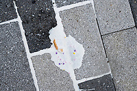 A melted Unicorn Taiyaki ice cream cone from Taiyaki NYC is seen on the pavement in the Seaport area of Boston, Massachusetts, USA, on Sat., July 20, 2019.