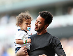 Tottenham's Mousa Dembele with his child after the Barclays Premier League match at the White Hart Lane Stadium.  Photo credit should read: David Klein/Sportimage
