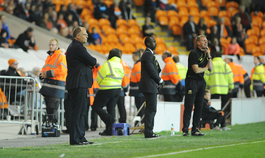 Blackpool manager Neil McDonald (left) looks on as his side suffers a second home defeat<br /> <br /> Photographer Kevin Barnes/CameraSport<br /> <br /> Football - The Football League Sky Bet League One - Blackpool v Burton Albion - Tuesday 18th August 2015 - Bloomfield Road - Blackpool<br /> <br /> &copy; CameraSport - 43 Linden Ave. Countesthorpe. Leicester. England. LE8 5PG - Tel: +44 (0) 116 277 4147 - admin@camerasport.com - www.camerasport.com