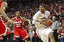 January 20, 2014: Shavon Shields (31) of the Nebraska Cornhuskers drives to the basket against LaQuinton Ross (10) of the Ohio State Buckeyes with Lenzelle Smith Jr. (32) of the Ohio State Buckeyes looking on at the Pinnacle Bank Arena, Lincoln, NE. Nebraska won in the game against Ohio State 68 to 62.