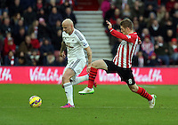 Pictured Jonjo Shelvey of Swansea challenged by a SOuthampton player Sunday 01 February 2015<br /> Re: Premier League Southampton v Swansea City FC at St Mary's Ground, Southampton, UK.
