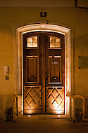 A wooden door at night in L' Isle-sur-la-Sorgue, France