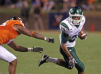 Oct 23, 2010; Charlottesville, VA, USA;  Eastern Michigan Eagles running back Javonti Greene (32) runs in front of Virginia Cavaliers linebacker Ausar Walcott (26) during the 1st half of the game at Scott Stadium.  Mandatory Credit: Andrew Shurtleff