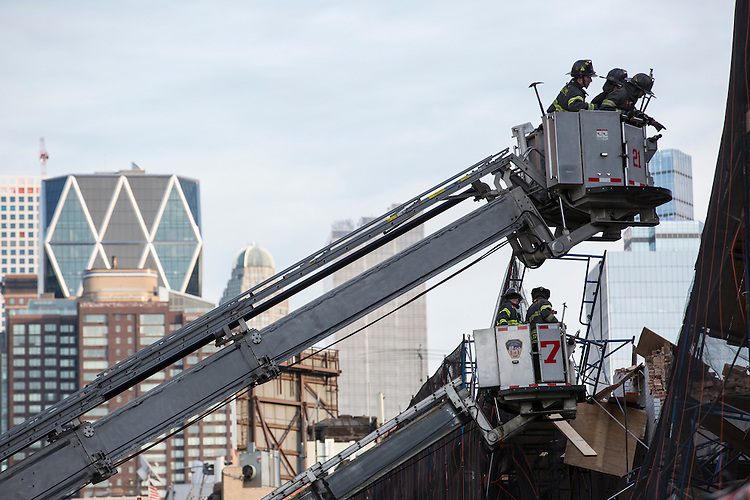 A building under demolition partially collapses on Manhattan&rsquo;s Far West Side at 642 w. 57th street. One person was trapped and rushed to the hospital after being extracted and is in critical condition. The building is said to have collapsed around 2:30pm.<br /> <br /> Here, New York City firefighters work on surveying the building's collapse.<br /> <br /> Photographed on February 25, 2015 by Mark Abramson for the Wall Street Journal.