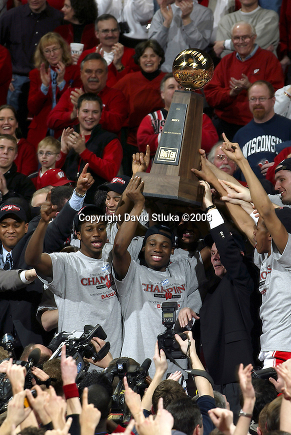 Madison, WI, 3/5/03 - University of Wisconsin shows off the Big Ten Trophy after winning back to back Big Ten Championships at the Kohl Center. The Badgers 60-59 victory over Illinois marks the first outright conference title for Wisconsin since 1947. ©David Stluka