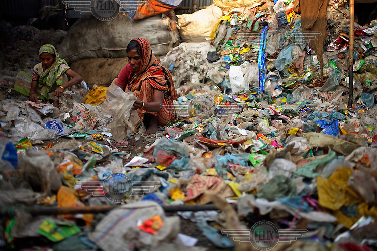 Women working in a plastic recycling plant in Dhaka.