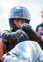Mar 15, 2019; Gainesville, FL, USA; NHRA pro stock motorcycle rider Jianna Salinas puts on her riding gloves during qualifying for the Gatornationals at Gainesville Raceway. Mandatory Credit: Mark J. Rebilas-USA TODAY Sports