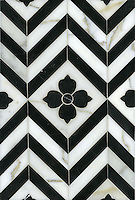 Maharaja 1, a waterjet stone mosaic shown in polished Nero Marquina and honed Calacatta Tia, is part of the Silk Road collection by Sara Baldwin for New Ravenna.