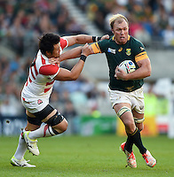 Schalk Burger of South Africa fends Shinya Makabe of Japan. Rugby World Cup Pool B match between South Africa and Japan on September 19, 2015 at the Brighton Community Stadium in Brighton, England. Photo by: Patrick Khachfe / Onside Images