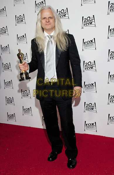 Claudio Miranda.2013 Twentieth Century Fox & Fox Searchlight Pictures Oscar Party held at  Lure, Hollywood, California, USA..February 24th, 2013.oscars full length black white shirt grey gray tie award trophy winner.CAP/ADM/DAN.©Dan Scott/AdMedia/Capital Pictures.