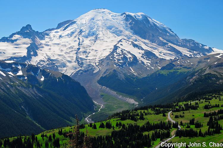 Sunrise road leads towards Mount Rainier