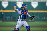 Mike Rivera (4) of the Florida Gators throws during a game between the Miami Hurricanes and Florida Gators at TD Ameritrade Park on June 13, 2015 in Omaha, Nebraska. (Brace Hemmelgarn/Four Seam Images)