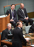 AUSTRALIA, Canberra : David Cameron Prime Minister of the United Kingdom (TL) listens to Australian Prime Minister Tony Abbott during an addresses to the House of Representatives at Parliament House in Canberra on November 14, 2014. AFP PHOTO / MARK GRAHAM