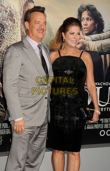 """Tom Hanks, Rita Wilson.Los Angeles premiere of Warner Brothers Pictures' """"Cloud Atlas"""" at Grauman's Chinese Theater. Hollywood, CA USA..October 24th, 2012.half 3/4 length black dress clutch bag married husband wife white shirt check tie grey gray suit moustache mustache facial hair .CAP/ROT/TM.© TM/Roth/Capital Pictures"""