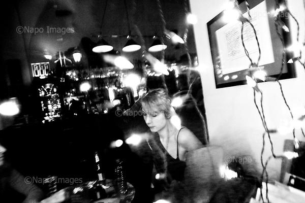 Wroclaw 01.2010 Poland<br /> Transsexual Marina Till in the pub.<br /> Marina Till, a transsexual, has had numerous medical examinations and treatments, such as a very intense hormonal therapy, at times seriously weakening her organism. For a long time she has been dreaming  about a sex change surgery that she can not afford. She does not accept herself and her body. Frequent suicide attempts and alcohol abuse, are means of escape from the body she lives in. A body that does not belong to her.<br /> Photo: Adam Lach / Napo Images<br /> <br /> Transseksualista Marina Till w pubie.<br /> Transseksualista Marina Till przeszla juz setki kuracji hormonalnych i badan psychoterapeutycznych, ktore w znaczny sposob wycienczyly jej organizm. Od wielu lat marzy o zmianie plci lecz najzwyczajniej nie stac ja na zbyt kosztowna operacje. Nie akceptuje siebie, nie akceptuje swojego ciala. Czeste proby samobojcze i znaczne ilosci alkoholu sa dla niej sposobem na ucieczke, przede wszystkim od swiadomosci ze cialo w ktorym zyje nie nalezy do niej.<br /> Fot: Adam Lach / Napo Images