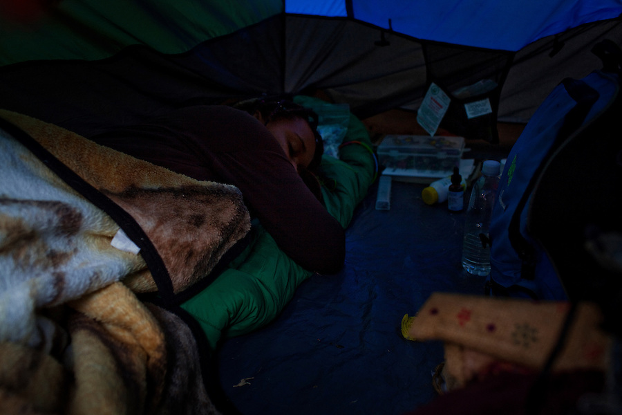 Los Angeles, California, October 23, 2011 –A mof Occupy Los Angeles naps during theoccupation of Los Angeles City Hall.