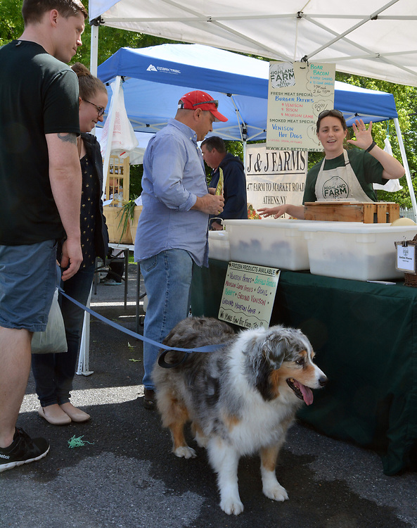 A customer visiting the Highland Farm booth at the Opening Day of the 2017 Saugerties Farmer's Market on Saturday, May 27, 2017. Photo by Jim Peppler. Copyright/Jim Peppler-2017.