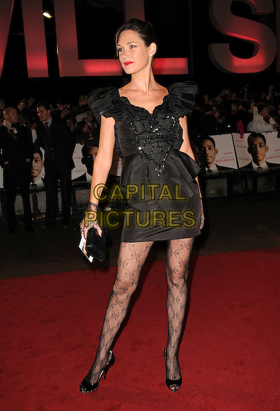 "NICOLE MERRY .Attending the UK Film Premiere of ""Seven Pounds"" at the Empire Cinema, Leicester Square, London, England, January 14th 2009..full length black  dress beaded lace gloves lacy tights patterned open toe shoes patent clutch bag.CAP/CAS.©Bob Cass/Capital Pictures"