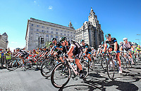Picture by Alex Whitehead/SWpix.com - 07/09/2014 - Cycling - 2014 Friends Life Tour of Britain - Stage 1, Liverpool - The peloton led by Omega Pharma Quick-Step's Mark Cavendish (near) and Team Sky's Bradley Wiggins ride past the Royal Liver Building and Cunard Building during Stage 1 of the Tour of Britain in Liverpool.